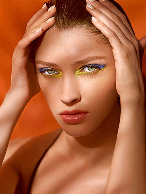 Woman with bright eye makeup, textured manicure, summer beauty