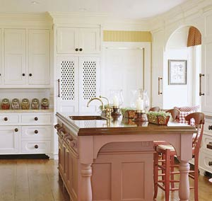 White kitchen with brown island