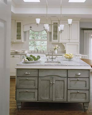 White kitchen with green island