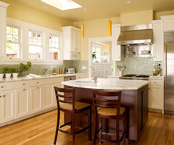 Dark-wood island with white cabinetry