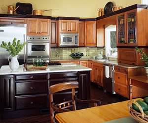 Dark-wood island with medium-wood cabinetry