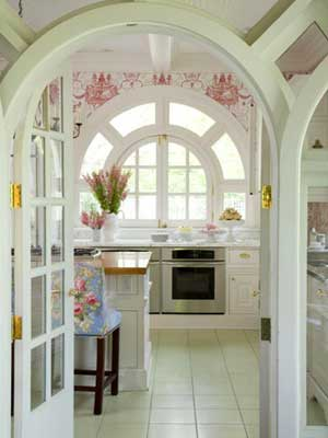 Kitchen with arched doorways and red wallpaper