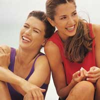 Two women laughing at the beach