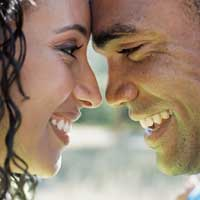 African-American Couple leaning foreheads against each other