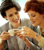 Two women drinking coffee