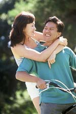 Asian-American couple in playful embrace