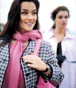Brunette Woman in Tweed Jacket with Pink Scarf