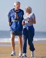 Senior couple exercising on beach
