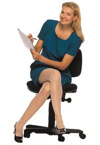 Business woman sitting in office chair
