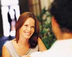 Woman looking at man across restaurant table