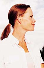 Woman with ponytail looking off to the side