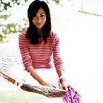 Woman on hammock in striped shirt