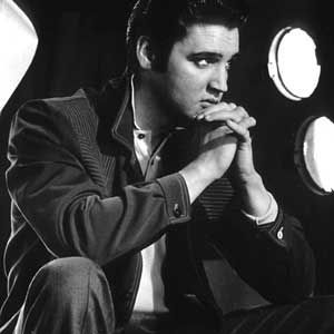 Elvis Sitting Behind the Scenes
