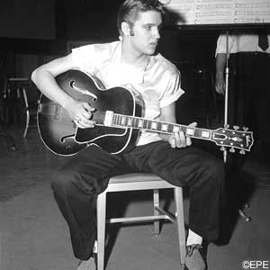 Elvis Playing Guitar Sitting Down