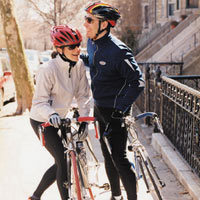 Couple with bicycles laughing