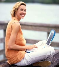 Woman At Waterfront On Laptop