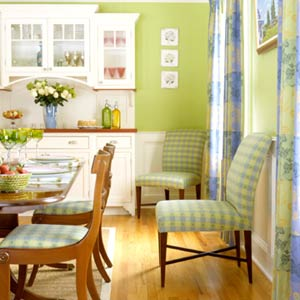 Green and Blue plaid chairs against the dining room wall
