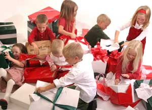 Septuplets opening presents