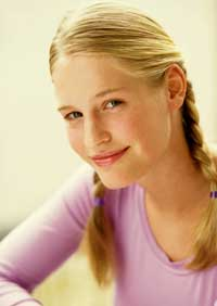 Blonde pre-teen girl smiling