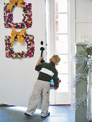 Boy at Door with holiday Wreaths