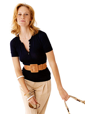 blonde woman wearing large tan belt