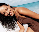woman in swimsuit leaning over laughing