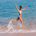 woman in bikini frolicking in ocean