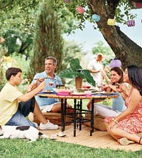 Family lounging around picnic table