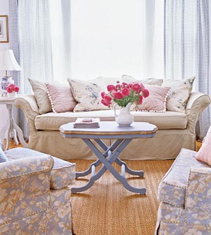 Lighten Up, Sitting Pretty, floral living room with red roses in white jug on coffee table