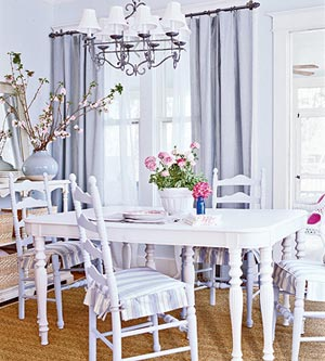Lighten Up, fine dining, white dining room with blue curtains and pink flowers on table