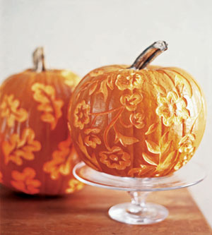 pumpkins with illuminated floral design