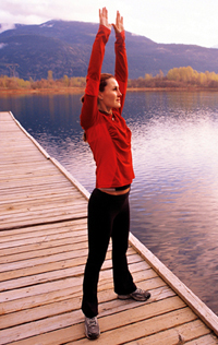 Woman exercising on a dock