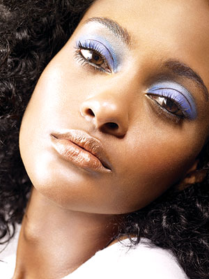 close-up of woman's face with blue eye shadow