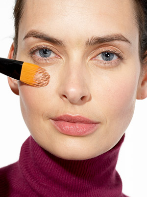 woman using synthetic brush for foundation