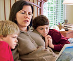 Mother reading to two sons