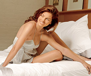 model sitting on bed