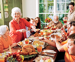 Paula Deen serving food to family