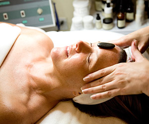 woman lying down getting facial