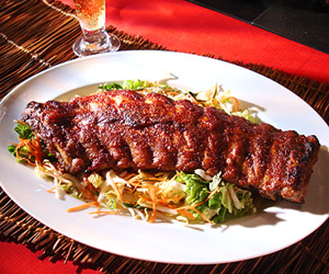 Oven Roasted Pork Ribs with Hoisin-Cranberry BBQ Sauce and Asian Coleslaw