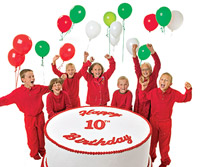 Septuplets with balloons and big cake