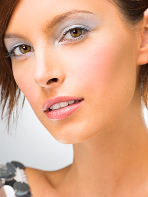 Woman in silver makeup
