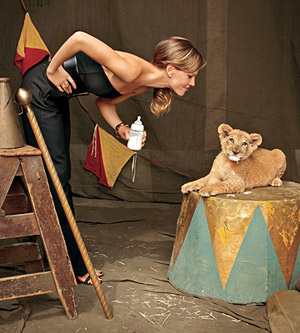 Hillary Swank facing cub with milk bottle