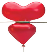 Heart balloon being squeezed by rope