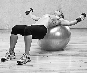 Dumbell Flys on Body Ball with Crunches - Down