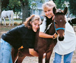 Szymanski sisters with pony