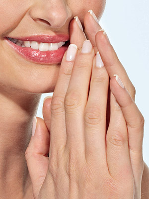 Model displaying french manicure