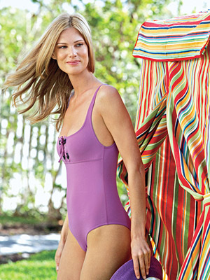 model in purple bathing suit