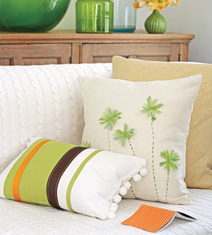 green, white and brown pillows