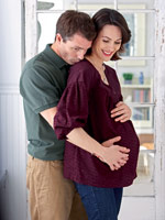 man holding pregnant wife