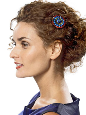model with brooch in hair